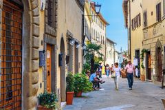 On the street in old medieval village Castellina in Chianti. Tuscany. Italy. Castellina in Chianti, Italy - September 29, 2018: On the street in old medieval stock image