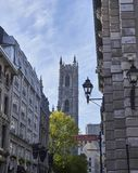 Street in the Old Montreal. Old Montreal street with a view of the basilica, old European style street stock photography
