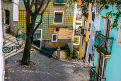 Street in the old neighborhood of Alfama, Lisbon royalty free stock photo