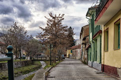 Street with old neoclassical buildings by the river in Florina, a popular winter destination in northern Greece Stock Photos