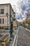 Street with old neoclassical buildings by the river in Florina, a popular winter destination in northern Greece. On an overcast day Stock Photography