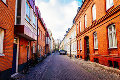 Street with old nice colorful houses in historical center of Malmo Stock Images