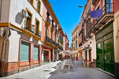 Street in old part of Seville town on summer day, Spain. Royalty Free Stock Images