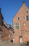 Street in the old quarter Begijnhof in Leuven Stock Photos