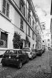 Street in old Rome with cars parked on a roadside Royalty Free Stock Photo