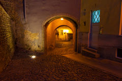 Street in old Tallinn by night Stock Photos
