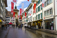 The street and old tower in Solothurn. SOLOTHURN, SWITZERLAND - SEPTEMBER 16, 2015: Cityscape of the city, with the population of approx. 16500 citizens it is stock image