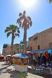 Street in the old town of Acre, Israel. ACRE, ISRAEL - April 11, 2019: picturesque street in the old town with stalls of street vendors in Acre  Akko , Israel royalty free stock photo
