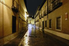 Street in the old town of Alcala de Henares, Spain called. `de la Imagen` on a rainy and very lonely night Stock Photography
