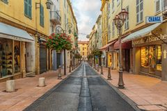 Street in the old town Antibes in France. ANTIBES, FRANCE - NOVEMBER 3, 2014: Street in the old town stock photography