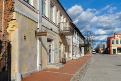 Street of old town of Bauska town with old houses and small souvenir shops Stock Images