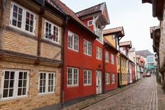 Street in old town of Flensburg, Germany. Colorful living houses in a row along the street in old town of Flensburg, Germany Stock Images