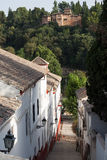 Street in old town of Granada Spain with Alhambra Royalty Free Stock Photography