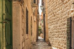 A street of the Old Town of Kotor. The old part of Kotor is a UNESCO World Heritage site and a famous tourist attraction. Stock Image