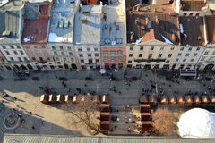 Street of the old town of Lviv. Top view of the old street of Lviv. Central Square. Beautiful roof. Christmas Eve. Horse on the roof Royalty Free Stock Images