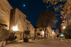 Street in the old town Mougins in France. Night view. Street with flowers in the old town Mougins in France. Night view stock image