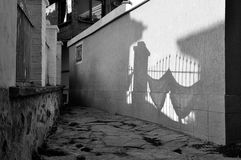 Street of the old town of Nesebar in Bulgaria with shadow on white wall Stock Images