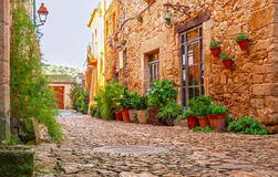 A street in the old town of Peratallada, Catalonia, Spain. Medieval street in the mediaval town in Europe. Panoramic view of old. Town in beautiful evening royalty free stock photography