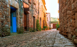 A street in the old town of Peratallada, Catalonia, Spain. Medieval street in the mediaval town in Europe. Panoramic view of old. Town in beautiful evening royalty free stock photos