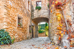 A street in the old town of Peratallada, Catalonia, Spain. Medieval street in the mediaval town in Europe. Panoramic view of old. Town in beautiful evening stock photo