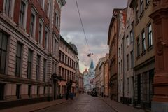Street in the old town of Riga, leading to the white Church. stock photo