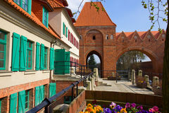 Street in old town of Torun,  Poland. Street in old town with tower of Teutonik knights castle, Torun, Poland Stock Images