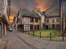 A street in the old town of Troyes (France) and cobblestone pavement in the foreground and old buildings royalty free stock photography