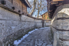 Street in old town and wooden house in Bansko,  Blagoevgrad region Stock Photos