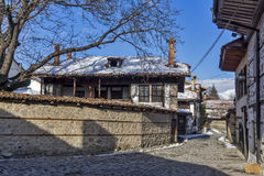 Street in old town and wooden house in Bansko,  Blagoevgrad region Stock Photo