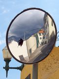 Street of old traditional houses in funchal madeira reflected in an old cracked traffic mirror against a blue sky. A street of old traditional houses in funchal stock images