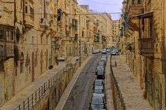 Street in Old Valletta, Malta. Stone houses lining a back street in an old quarter of Valletta, Malta Royalty Free Stock Photos