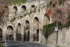 Street with old wall arch ruins in Bergamo town, Italy Stock Image