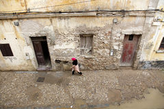 Street. An old street with a woman in fez, marocco Stock Images