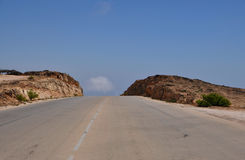 Street in the Omani mountains. A new street in the Omani mountains near the city of Salalah royalty free stock photo
