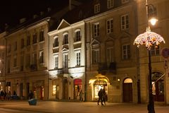 WARSAW, POLAND - JANUARY 02, 2016: Night view of the Krakow suburb st. in Warsaw. The street is one of the best known and most prestigious streets of Poland`s Royalty Free Stock Images