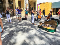 Street orchestra plays on weekend outside Palais Royal Royalty Free Stock Images