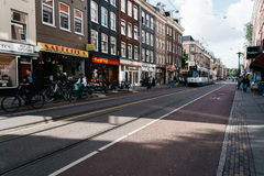 Street in Oude Pijp, a neighborhood in Amsterdam, a cloudy day o Royalty Free Stock Images