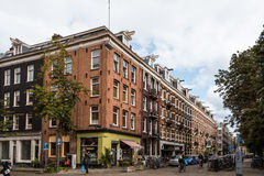 Street in Oude Pijp, a neighborhood in Amsterdam, a cloudy day o Stock Photos