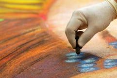 Street Painter. A street painter at work on the asphalt stock photos