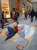 Street painter with chalk. Artwork done in chalk, made in a street in the center of Florence, Italy royalty free stock photos