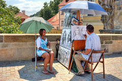 Street painter on Charles Bridge in Prague. Royalty Free Stock Photo