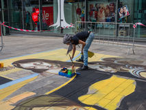 Street painter at work Stock Photography