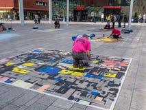 Street painter at work Stock Photos