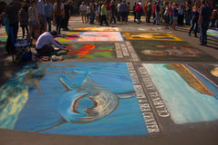 Street Painters. I Madonnari, or street painters, transform the Mission plaza using pastels on pavement to create 150 vibrant and colorful, large scale images Stock Images