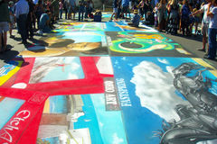 Street Painters. I Madonnari, or street painters, transform the Mission plaza using pastels on pavement to create 150 vibrant and colorful, large scale images Royalty Free Stock Image