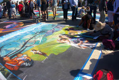 Street Painters. I Madonnari, or street painters, transform the Mission plaza using pastels on pavement to create 150 vibrant and colorful, large scale images Royalty Free Stock Images