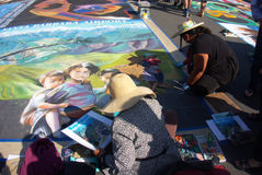 Street Painters. I Madonnari, or street painters, transform the Mission plaza using pastels on pavement to create 150 vibrant and colorful, large scale images Stock Photo