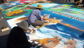 Street Painters. I Madonnari, or street painters, transform the Mission plaza using pastels on pavement to create 150 vibrant and colorful, large scale images Royalty Free Stock Photo