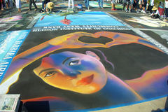 Street Painters. I Madonnari, or street painters, transform the Mission plaza using pastels on pavement to create 150 vibrant and colorful, large scale images Royalty Free Stock Photography