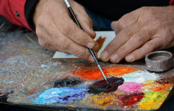 Street painting. A man paints in the street landscapes Stock Photo